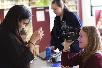 Students and educators engaged in creating media